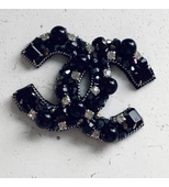 CC brooch in black colour